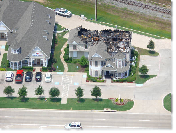 aerial photography of real estate office after a fire